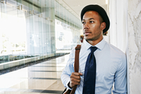 Black businessman standing in office lobby