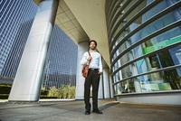 Black businessman standing outside office building