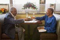 Older couple celebrating anniversary in restaurant