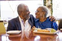Older couple hugging in restaurant