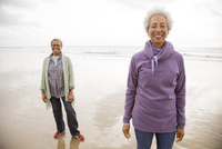 Older African American women walking on beach