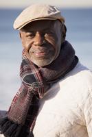 Older African American man smiling on beach