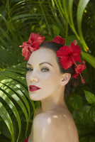 Pacific Islander woman wearing flowers and glamorous makeup