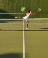 Pacific Islander woman playing tennis