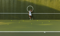 Pacific Islander woman standing on tennis court