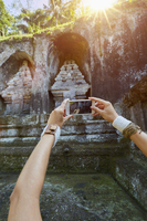 Pacific Islander woman photographing monument