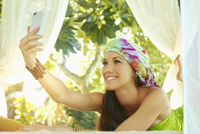 Pacific Islander woman taking selfie in gazebo