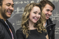 Students smiling in college classroom