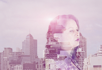 Double exposure of mixed race woman and cityscape