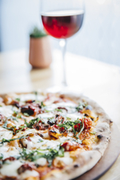 Glass of wine and pizza