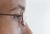 Close up profile of eyes and eyeglasses of Black man