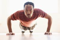 Black man doing push-ups