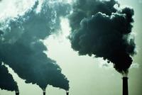 Smoke billowing from industrial smoke stacks