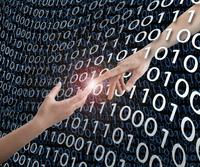 Glowing fingers touching in binary code
