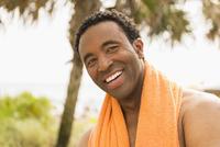 Black man smiling on beach