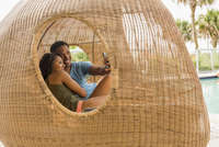 Couple taking selfie in cabana