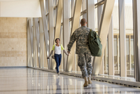 Returning soldier greeting girlfriend in airport