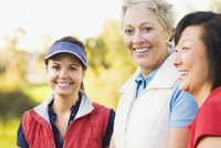 Women smiling on golf course