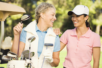 Women laughing on golf course