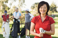 Women playing golf on golf course