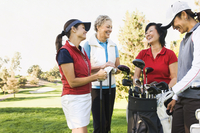 Women talking on golf course