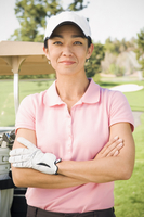 Mixed race woman smiling on golf course