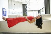 Chinese woman laying on sofa