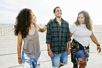Friends laughing on boardwalk