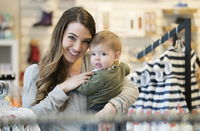 Caucasian mother and baby son shopping in clothing store 11018071407| 写真素材・ストックフォト・画像・イラスト素材|アマナイメージズ