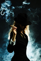 Silhouette of Caucasian woman smoking cigar