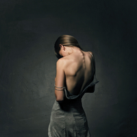 Caucasian girl exposing back in unzipped dress