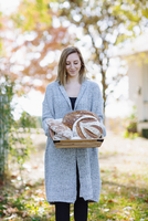 Caucasian woman holding bread outdoors