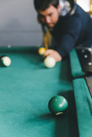 Hispanic man playing pool