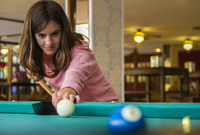 Caucasian woman playing pool
