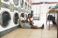 Couple doing laundry at laundromat