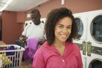 Woman smiling in laundromat