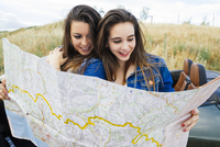 Women reading map on road trip