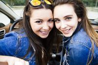 Women smiling in convertible