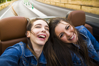 Women laughing in convertible
