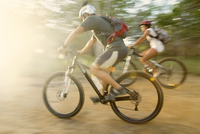 Blurred view of couple riding mountain bikes