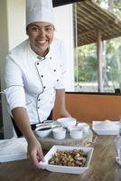 Hispanic chef serving food in restaurant