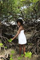 Black woman smiling in mangrove jungle