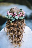 Caucasian woman wearing flower crown