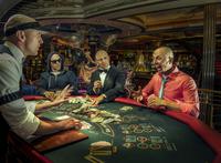 Multiple exposure of gamblers playing poker in casino