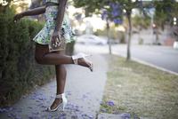 Woman wearing heels on neighborhood sidewalk