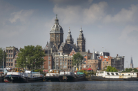 Ornate building over Amsterdam canal, Amsterdam, Holland