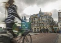 Blurred bicyclist on city street
