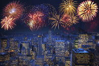 Fireworks exploding over illuminated cityscape, New York, New York, United States