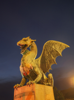 Illuminated dragon statue against night sky