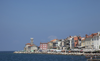 Piran waterfront under blue sky, Adriatic Sea, Slovenia